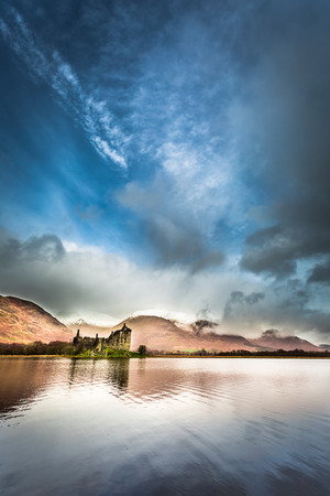 typically scottish: Ruins of the castle on the lake Stock Photo