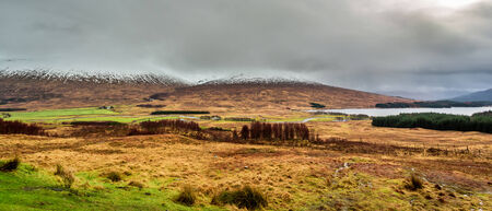 highland region: Snowy mountains and a lake in Scotland Stock Photo