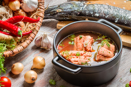 Fish soup made of fresh vegetables and salmon photo
