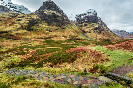highlands region: Mountain footpath leading to the peak in Scotland Stock Photo