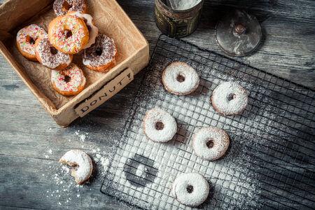 Tasting freshly baked donuts photo