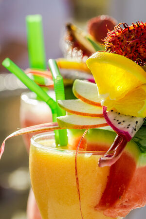 Closeup of drink with watermelon and fresh fruits photo