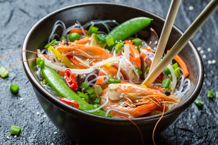 Noodles with vegetables and shrimps photo