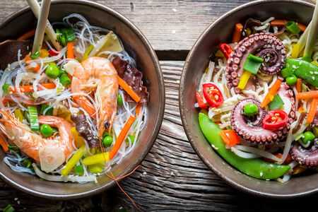 Two dishes with vegetables and seafood photo