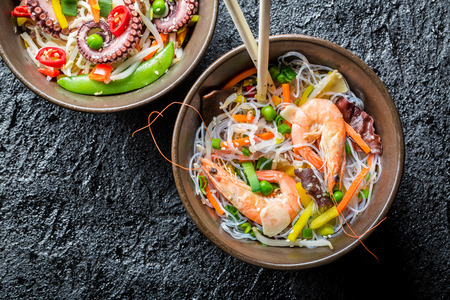 thai pepper: Chinese noodles with vegetables and seafood Stock Photo