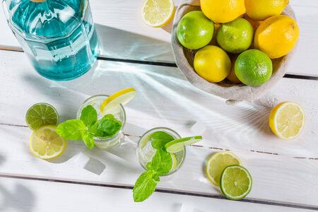 Closeup of citrus drink in summer garden photo