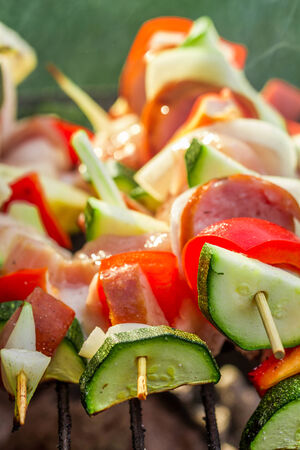 Closeup of skewers with vegetables on the grill photo