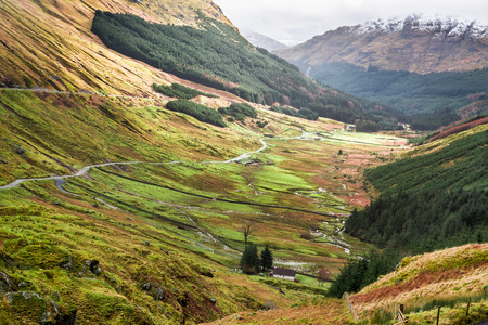 highland region: Winding road over a mountain canyon