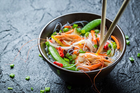 Noodles with vegetables and prawns photo