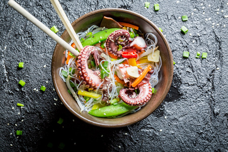 Vegetables with noodles and octopus photo