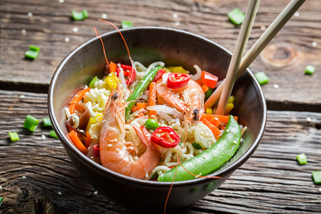 Shrimp with vegetables and noodles photo