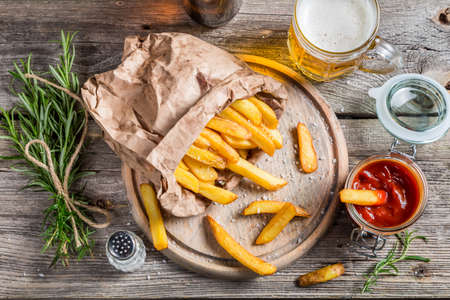 Homemade fries served with beer photo
