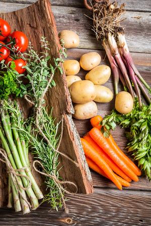 old farmer: Fresh various vegetables on bark