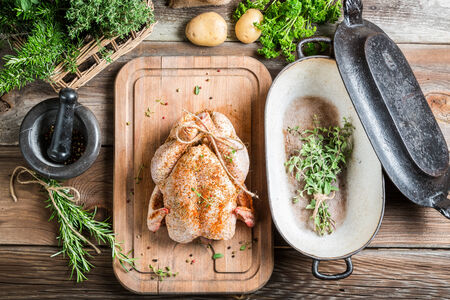 Preparation for roasting chicken with herbs photo