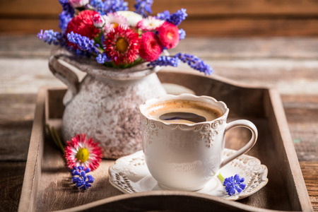 Closeup of coffee and spring flowers photo