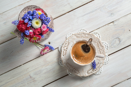 Daisy flowers and cup of coffee photo