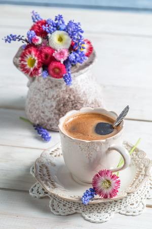 Cup of coffee and spring flowers photo