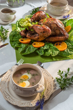 Roasted turkey for Thanksgiving served with soup photo