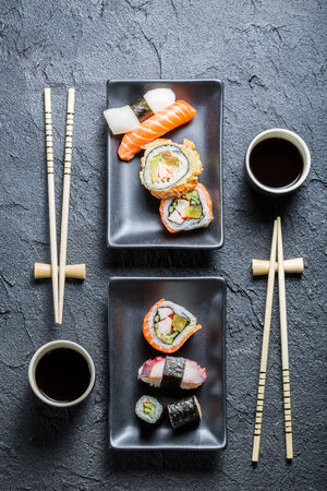 Sushi for two served on black stone photo