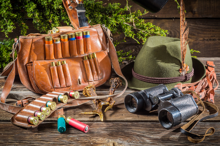 cartridge belt: Bag with bullets in a hunting lodge