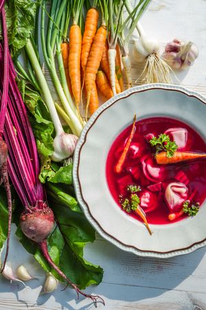 Beetroot soup with fresh vegetables photo