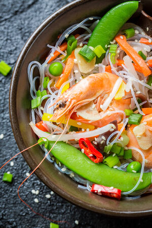 Shrimp and vegetables served with noodles photo