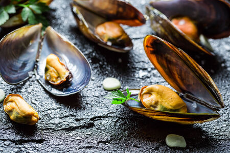 Fresh mussels served with garlic and parsley photo