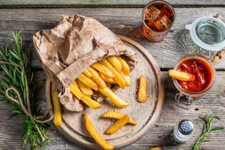 Homemade fries served with cold drink photo