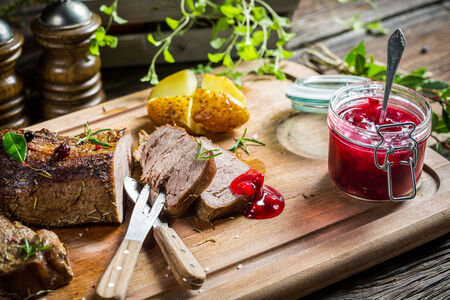 deer hunting: Venison with cranberry sauce