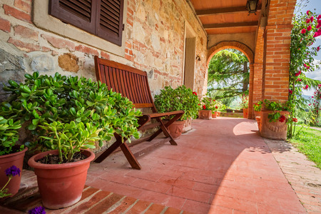 Beautiful porch in front of an home in Tuscany photo