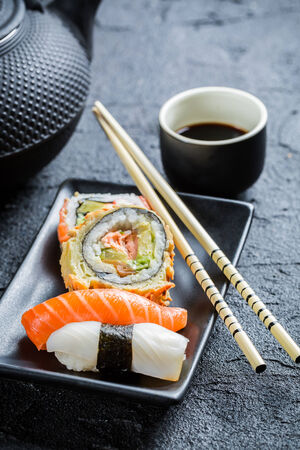 Fresh sushi served in with tea photo