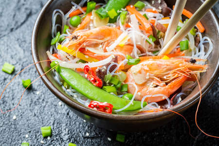 Traditional dish with shrimp and noodles photo