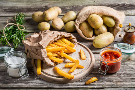 Homemade fries with salt and herbs photo
