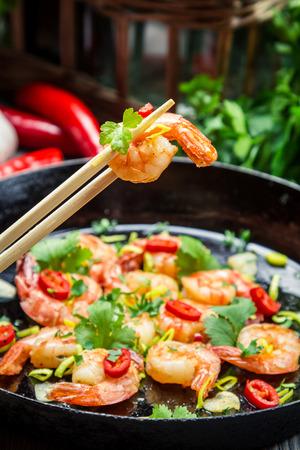 Fried shrimp with fresh herbs photo