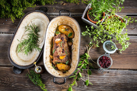 Roasted venison with herbs and vegetables photo