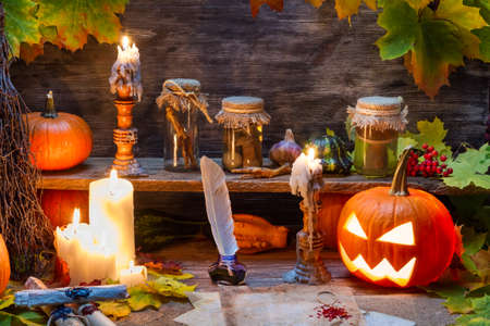 Witch table with halloween pumpkin photo
