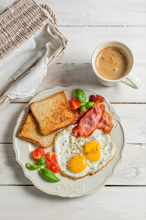 Eggs, bacon and toast for breakfast photo