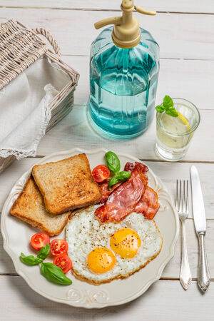 Eggs, toast and bacon for a summer breakfast photo