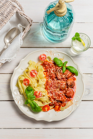Spaghetti with meatballs and cheese photo
