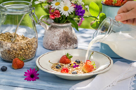 Oatmeal with fruit and milk photo