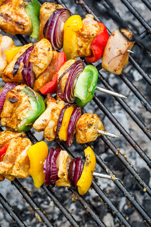 broiling: Grilled skewers on the grill Stock Photo