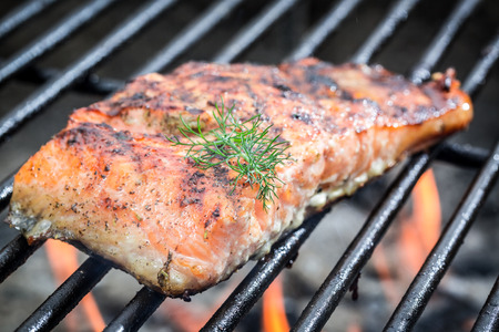 charcoal grill: Baked salmon on the grill with fire