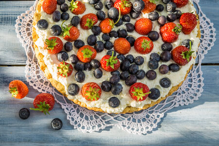 Tart with strawberries and blueberries photo