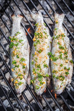 Grilled fish with lemon and spices photo