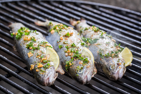 Baked fish with lemon and spices photo