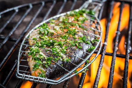 Grilled fish with spices on fire photo