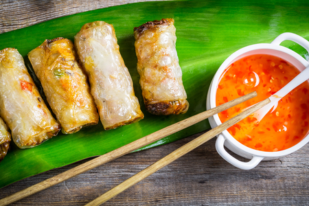 Close-up on spring rolls and sweet and sour sauce Banco de Imagens