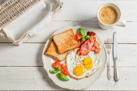 egg cups: Eggs, toast and bacon for breakfast Stock Photo