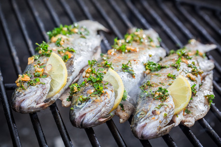 prepared fish: Grilled fish with lemon and spices Stock Photo