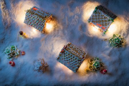 Gingerbread village in the snow on Christmas Eve photo